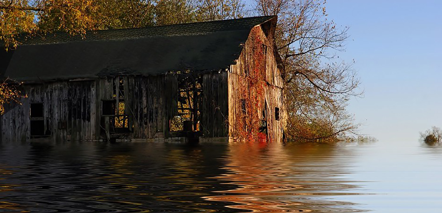 A flooded and vacant barn
