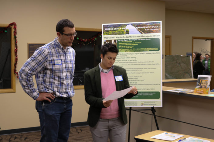 Middle Cedar project coordinator and watershed planner preparing for public meeting