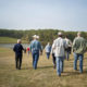 Public engaged in conversation with IFC Director at Soap Creek Watershed Tour
