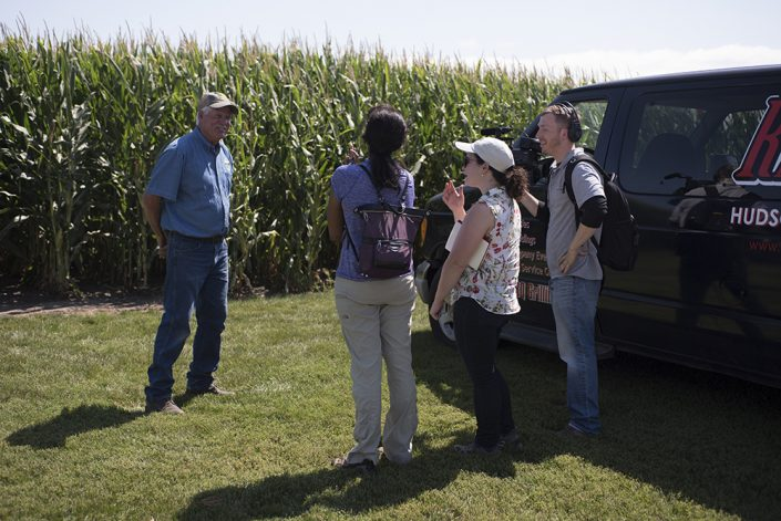 People Chatting in a corn field