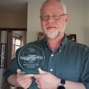 John Rathbun displays watershed award